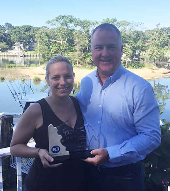 President Jim Arthurs presents CornerStone Dealer Award to Stephanie Keller, The Nickerson Corporation